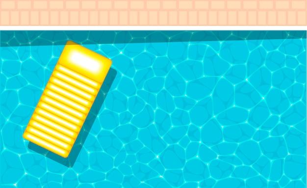 Żółty nadmuchiwany pływający w orzeźwiającym basenie