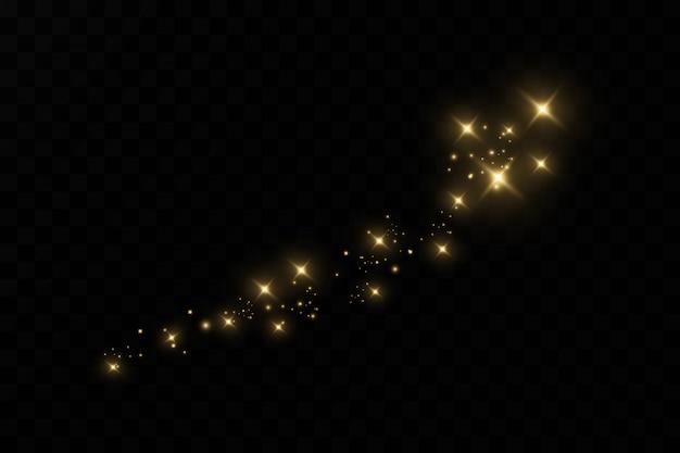 Żółty pył. efekt świetlny, efekt kurzu. cząsteczki pyłu migoczą na ciemnym tle.