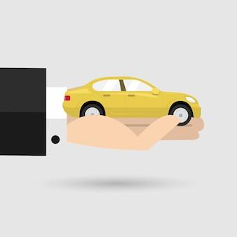 Żółty samochód w ręku biznesmen.