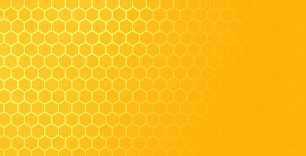 Żółty sześciokątny wzór siatki o strukturze plastra miodu z miejscem na tekst