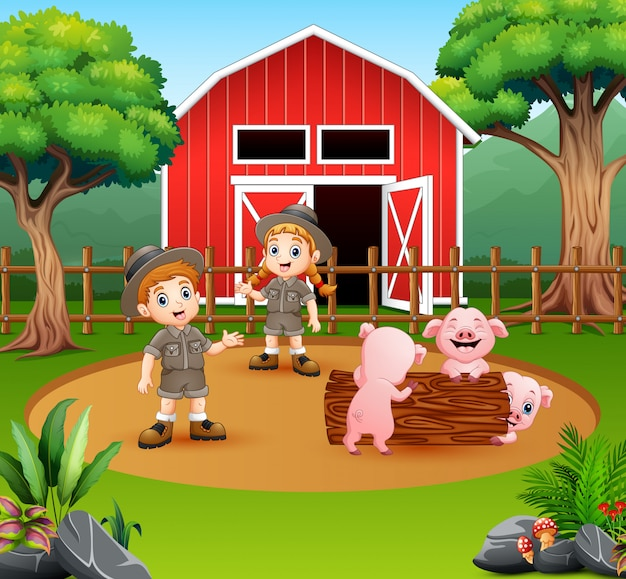 Zookeepers chłopiec i dziewczynka na podwórku gospodarstwa