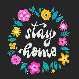 Zostań w domu, napis z kwiatami