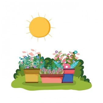 Zraszacz ogrodowy z rośliną doniczkową w parku