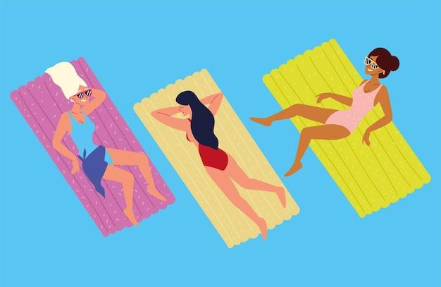 Zrelaksowane kobiety na pływakach