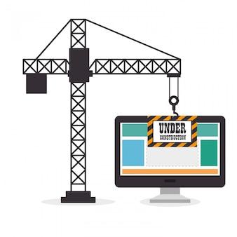 Żuraw trzyma stronę komputerową w budowie