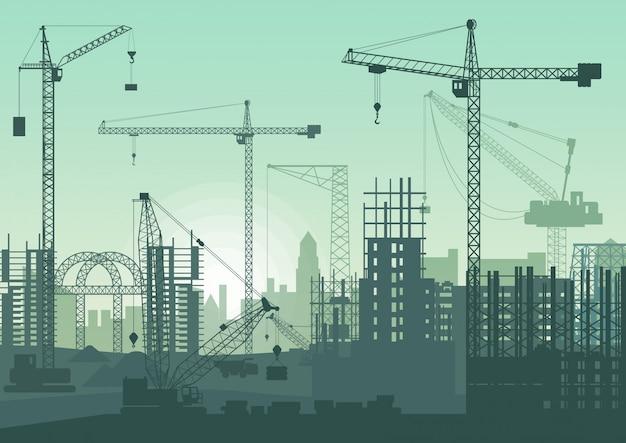 Żurawie wieżowe na budowie. budynki w budowie.