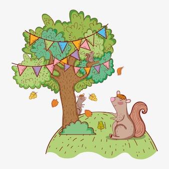 Zwierzę wiewiórka i drzewo z liści jesienią