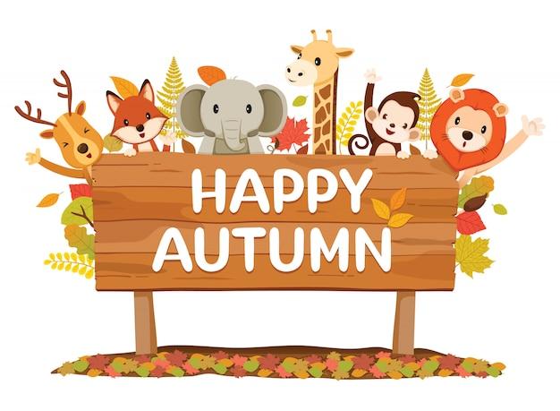 Zwierzęta na drewnianej tablicy z szczęśliwymi tekstami jesieni