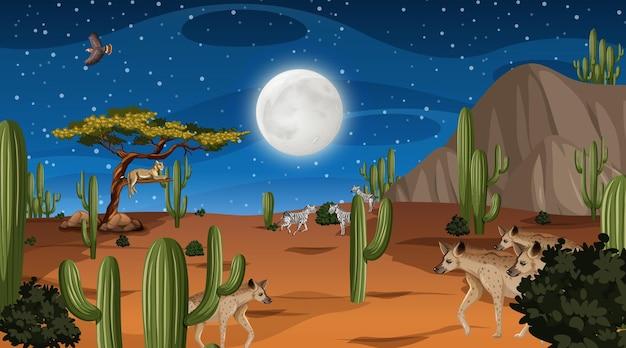 Zwierzęta żyją w pustynnym krajobrazie leśnym w nocnej scenie