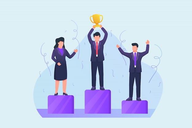 Zwycięzca konkursu biznesowego na podium z trofeum zwycięzcy