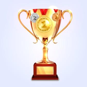 Zwycięzca złoty puchar z medalami.