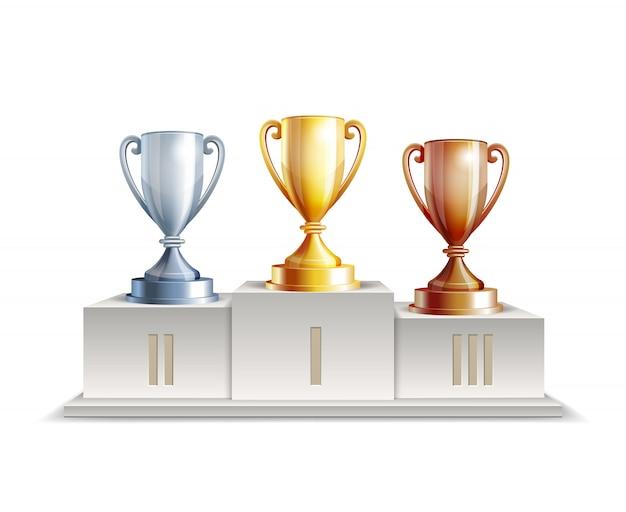 Zwycięzcy podium z pucharami trofeów