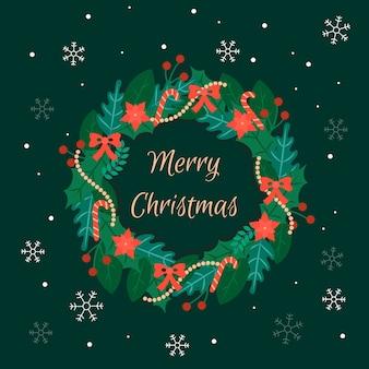Życzenia bożonarodzeniowe i wieniec w płaskiej konstrukcji
