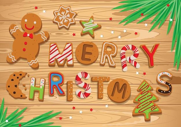 Życzenia bożonarodzeniowe z piernikami na drewnianym stole