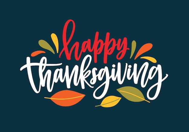 Życzenie szczęśliwego święta dziękczynienia napisane eleganckim pismem kaligraficznym i ozdobione opadłymi jesiennymi liśćmi