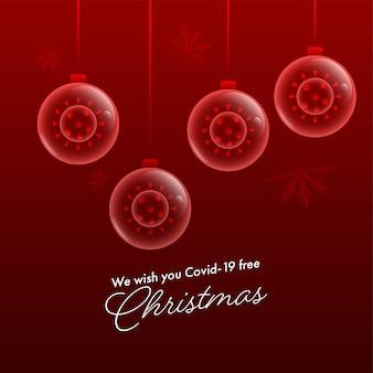 Życzymy świątecznej wiadomości tekstowej z koronawirusem wewnątrz przezroczystych bombek zawieszonych na ciemnoczerwonym tle.