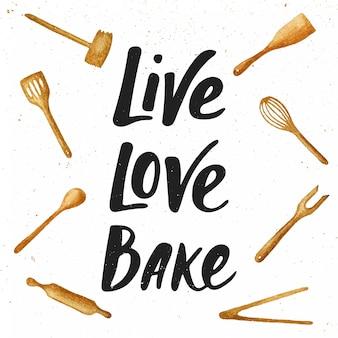 Żyj, kochaj, piec z narzędziami kuchennymi, napis