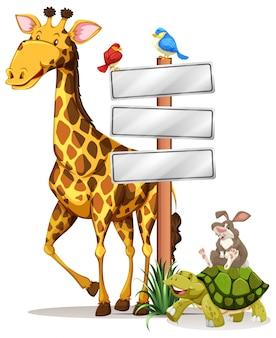 Żyrafa i inne zwierzęta przez znak