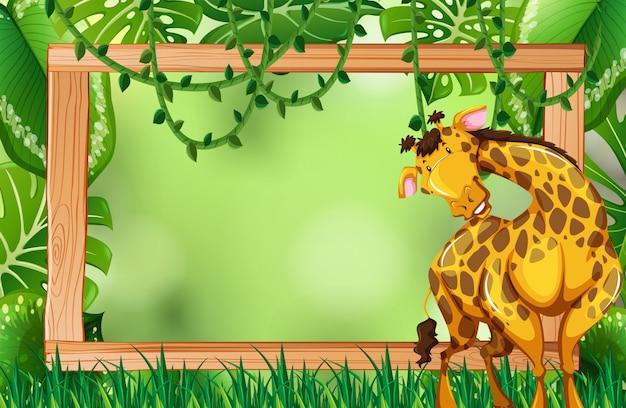 Żyrafa na zielonej ramie przyrody