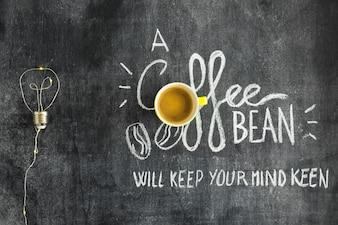 Żarówka robić z drutem i tekst pisać na chalkboard