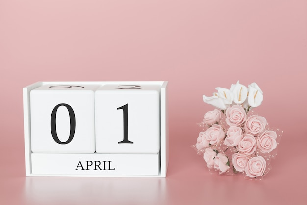 01 kwietnia. dzień 1 miesiąca. kostka kalendarza na nowoczesnym różu