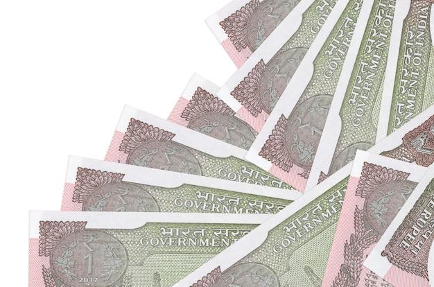 1 rupia indyjska rachunki leży w innej kolejności na białym tle