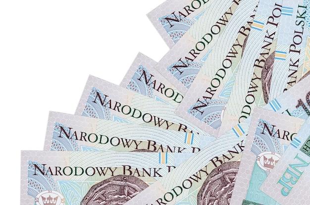 10 banknotów złotowych leży w innej kolejności na białym tle