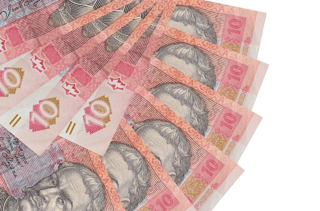 10 rachunków za ukraińskie hrywny leży na białej ścianie z miejsca na kopię ułożone w kształcie wentylatora z bliska. koncepcja transakcji finansowych