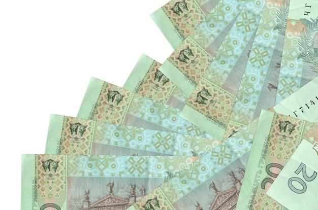 20 banknotów hrywny ukraińskiej leży w innej kolejności izolowanych. lokalna bankowość lub koncepcja zarabiania pieniędzy.