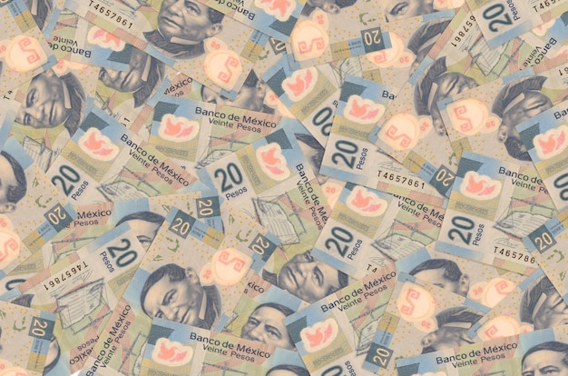 20 banknotów peso meksykańskich leży na stosie. koncepcyjne tło bogate życie. dużo pieniędzy