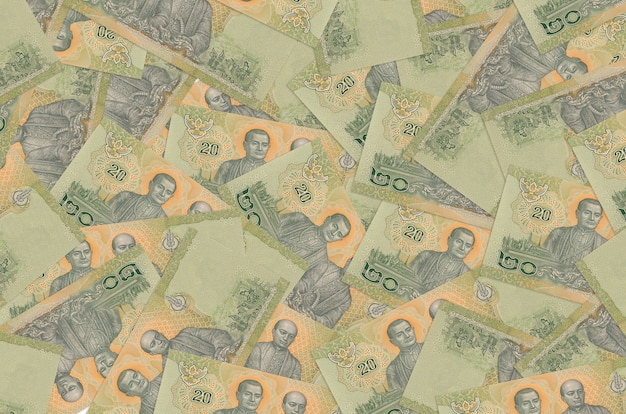 20 banknotów tajlandzkich leży na stosie. koncepcyjne tło bogate życie. dużo pieniędzy