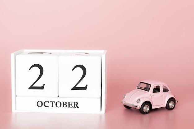 22 października. dzień 22 miesiąca. kalendarzowy sześcian z samochodem
