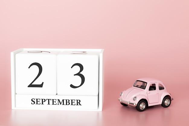 23 września. dzień 23 miesiąca. kalendarzowy sześcian z samochodem