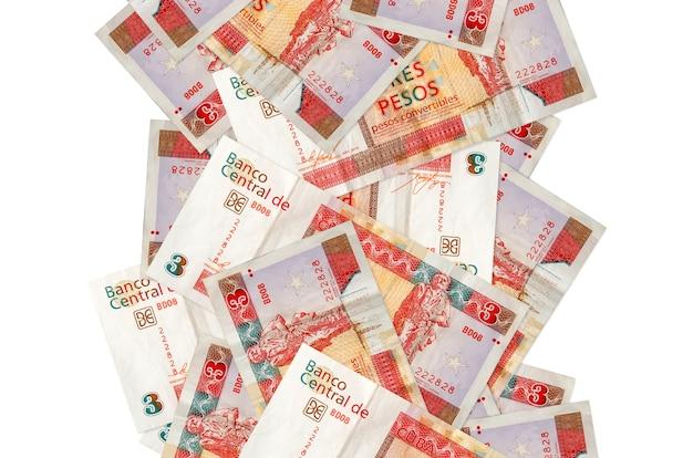3 rachunki wymienialne peso kubańskie pływające w dół na białym tle