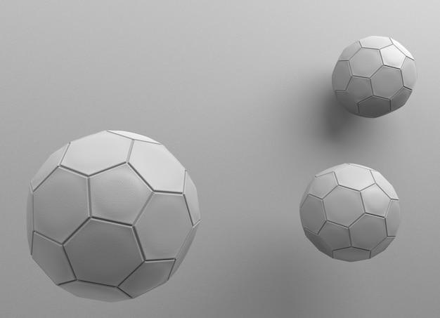 3 skórzane piłki z szarej ściany jako tło.