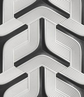 3d bezszwowy wzór w postaci białych modułów reliefowych z czarnymi elementami.