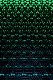 3d ilustracja rzędów czarnych kółek pod zielonym światłem neonu