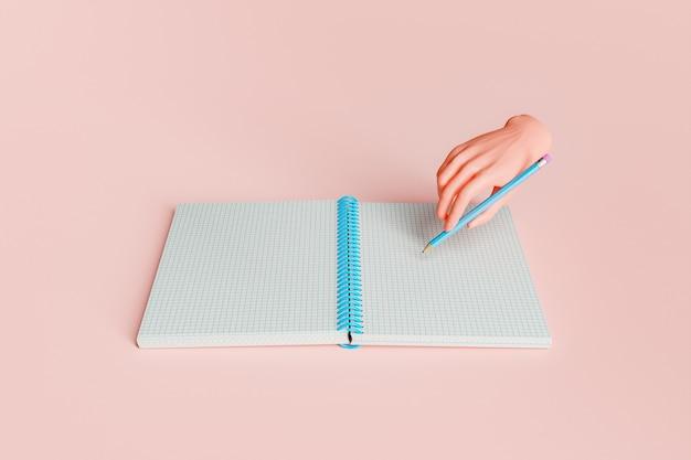 3d kreskówka ręka pisania w otwartym zeszycie