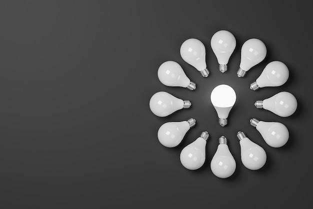 3d render krąg zapalonych żarówek na ciemnym tle