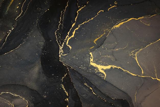 Abstarct płynne tło atramentu z czarnymi i złotymi plamami