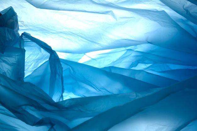 Abstrakcjonistyczna błękitna tekstura. plastikowa torba na tle. wzór plastikowej torby.