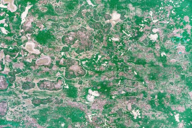 Abstrakcjonistyczna stara i zaniechana krekingowa epoksydowa zielona podłogowa tekstura. idealny do tła.