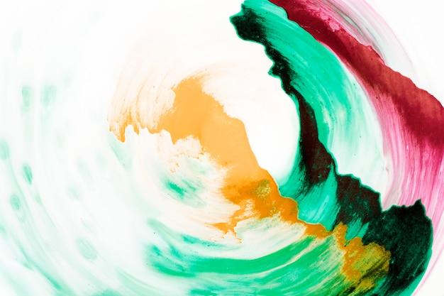 Abstrakcjonistyczna stubarwna ręka malujący tło