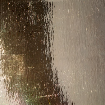 Abstrakcjonistyczna złocista tekstura na outside asfalcie