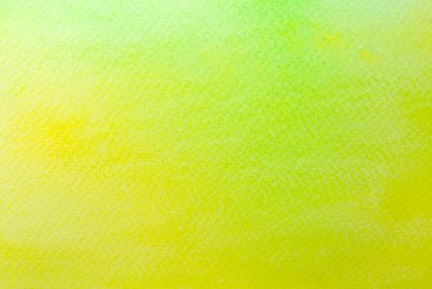 Abstrakcjonistyczna żółta i zielona akwarela na papierze