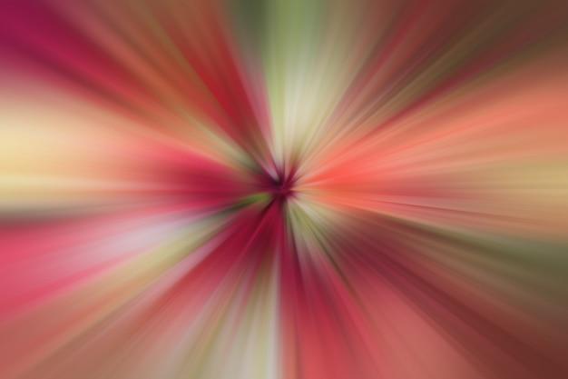 Abstrakcjonistyczne czerwone promienie światła od środkowego punktu błysku zaświecają tło