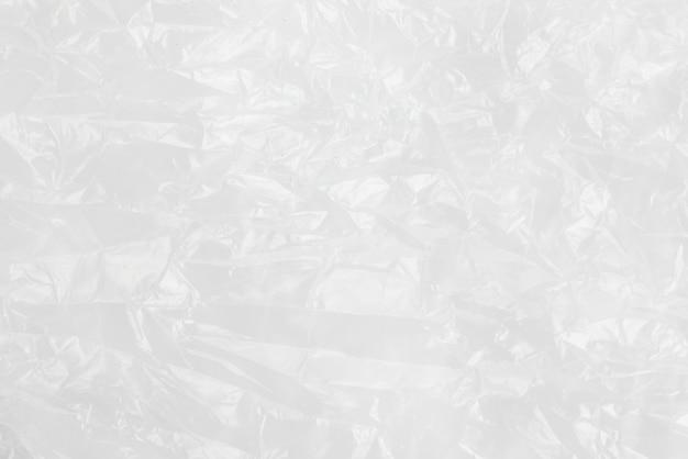 Abstrakcjonistycznej tło zmiętej plastikowej folii tekstury biały torba na śmiecie