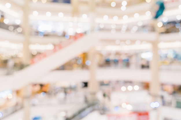 Abstrakcjonistyczni plamy tła tłumu ludzie w zakupy centrum handlowym dla tła, rocznik tonujący.