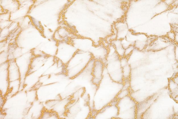 Abstrakcjonistyczny biały i złoty marmur teksturowane tło