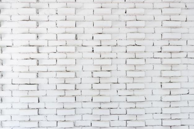 Abstrakcjonistyczny biały ściana z cegieł tło w wiejskim pokoju, grungy ośniedziali bloki kamieniarki architektury tapeta